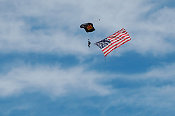 October 21, 2018 - Austin, TX, U.S. - AUSTIN, TX - OCTOBER 21: Parachute jumper brings American flag onto track prior to the F1 United States Grand Prix on October 21, 2018, at Circuit of the Americas in Austin, TX. (Photo by John Crouch/Icon Sportswire) (Credit Image: © John Crouch/Icon SMI via ZUMA Press)
