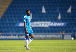 Kwame Poku of Colchester United with the club banners in the background - Mandatory by-line: Arron Gent/JMP - 18/06/2020 - FOOTBALL - JobServe Community Stadium - Colchester, England - Colchester United v Exeter City - Sky Bet League Two Play-off 1st Leg