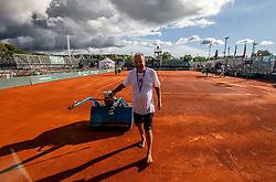 PORTOROZ, SLOVENIA - SEPTEMBER 17: Valter Gjorek preparing the court after heavy rain for Davis Cup Slovenia vs Paraguay at SRC Marina, on September 17, 2021 in Portoroz / Portorose, Slovenia. Photo by Vid Ponikvar / Sportida