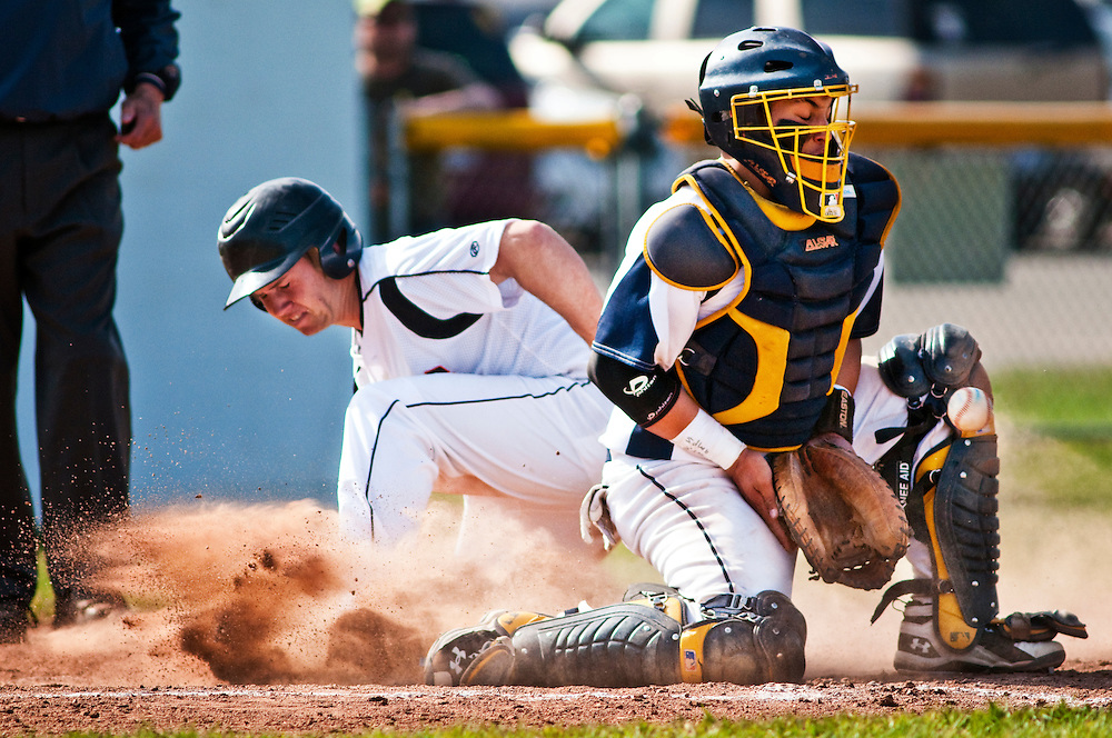 Matt Dixon | The Flint Journal..Flushing's Forrest Lansky is safe at home plate as Goorich catcher Trevor Troupe recives the throw moments late in the first game of a double header at Goodrich High School Thursday evening. Goodrich defeated Flushing 7-6 after eight innings.