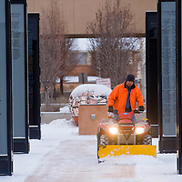 122712       Brian Leddy<br /> Norman Gray uses an ATV to remove snow from the McKinley County Courthouse Square Thursday morning. The area is expected to receive about an inch of snow Thursday.