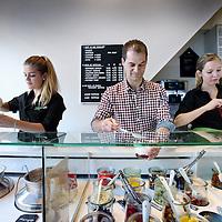 """Nederland, Amsterdam , 16 september 2013.<br /> Wouter Staal van de Yoghurt Barn in zijn winkel in de 1ste Van der Helststraat 80.<br /> Frozen yoghurt met notentopping, hangop met muesli, of boerenyoghurt met stukjes Bastognekoek. Voor Wouter en Esther Staal, oprichters van de Yoghurt Barn, zijn dit soort tractaties dagelijkse kost. """"Maar we genieten nog altijd van elke volle lepel.""""<br /> En die sensatie gunt het koppel (beiden 30), aangemoedigd door een groep enthousiaste donateurs en investeerders (crowdfunding), ook aan Amsterdam. Te beginnen in de Pijp, 1ste Van der Helstraat 80. Wouter: """"We zijn nu al bezig met de verbouwing en verwachten in augustus onze deuren te openen. Slaat het concept hier aan - wat we absoluut denken - dan willen we in Amsterdam en andere steden nog meer Yoghurt Barns uitrollen.""""<br /> Foto:Jean-Pierre Jans"""