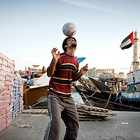 Dubai, United Arabs Emirates, 22 November 2008<br /> A dockers from Iran plays football in the Dubai creek.<br /> Photo: Ezequiel Scagnetti