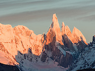 Cerro Torre in the shadow of Fitz Roy. Cerro Torre, one of the mountains of the Southern Patagonian Ice Field in South America, located in the border between Argentina and Chile, west of Cerro Chaltén (Fitz Roy).