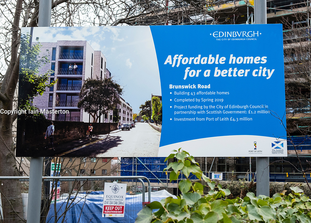 Sign outside new-build apartment building by Cala indicating that homes are affordable homes in Edinburgh, Scotland, United Kingdom