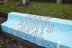 London, UK. 25 November, 2019. A banner used by campaigners from Amnesty International UK's Children's Human Rights Network and PRCBC protesting outside the Home Office to call on the British Government to stop selling children's rights. Currently, the Home Office charges £1,012 for citizenship applications, including for children living in poverty or local authority care, whilst the cost of processing an application is £372. Thousands of children with rights to British citizenship are prevented from claiming their rights due to excessive fees.