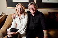Valerie Plame-Wilson and Joe Wilson posing inside a Four Seasons Hotel in Beverly Hills.