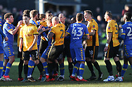 Robbie Willmott of Newport County (7) holds his shirt after he was spat on by Samual Saiz of Leeds Utd (in centre)  late in the match, leading to all the players getting involved in a scuffle and a red card for Leeds player Samual Saiz for spitting at Willmott. Emirates FA Cup , 3rd round match, Newport county v Leeds Utd at Rodney Parade in Newport, South Wales on Sunday 7th January 2018.<br /> pic by Andrew Orchard,  Andrew Orchard sports photography.