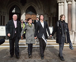 London - Alleged computer hacker Lauri Love outside the Royal Courts of Justice with his parents Rev Alexander Love and Sirkka-Liisa Love and girlfriend Sylvia Mann in London after he successfully challenged a ruling that he can be extradited to the US, following allegations that he hacked United States government websites. February 05 2018.