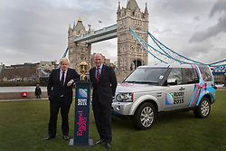© licensed to London News Pictures. London, UK 03/12/2012. Boris Johnson and England Rugby 2015 ambassador Lawrence Dallaglio posing with the Webb Ellis Cup at Potters Field, London, ahead of the Pool Allocation Draw for Rugby World Cup 2015. Photo credit: Tolga Akmen/LNP