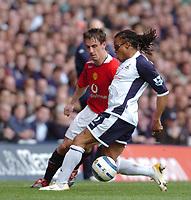 Photo: Leigh Quinnell.<br /> Tottenham Hotspur v Manchester United. The Barclays Premiership. 17/04/2006. Man Utds' Gary Neville puts the ball through the legs of Tottenhams Edgar Davids.