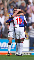 Photo. Jed Wee<br /> Blackburn Rovers v Wolverhampton Wanderers, FA Barclaycard Premiership, Ewood Park, Blackburn. 16/08/2003.<br /> Blackburn's Dwight Yorke congratulates Brett Emerton after the latter scores on his debut.