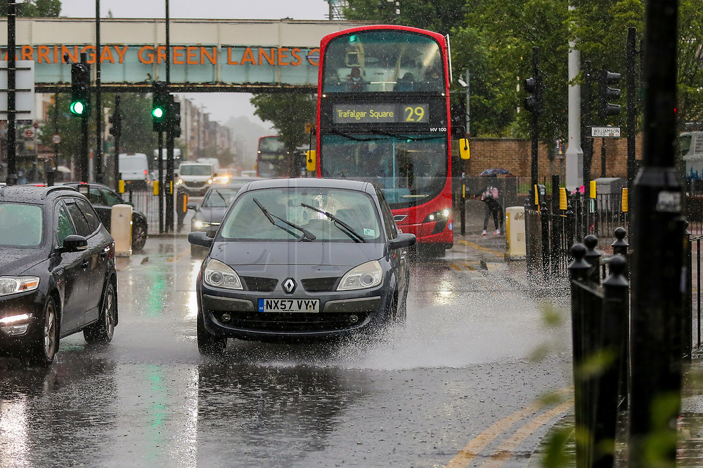 © Licensed to London News Pictures. 18/06/2021. London, UK. A car ploughs through surface flood water in north London, as wet weather conditions continue after a warm dry spell.  Photo credit: Dinendra Haria/LNP