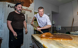 Pictured: Will Tebbutt watches as Willie Rennie gets involved<br /><br />Scottish Liberal Democrat leader Willie Rennie visited the Fudge Kitchen on Edinburgh's Royal Mile to talk about the need to protect Scottish businesses from independence.  I don't think master fudge maket Will Tebbutt needs t6o worry about his job.<br /><br />Ger Harley | EEm 2 December 2019