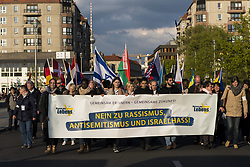 April 27, 2017 - Berlin, Berlin, Germany - On the occasion of the Jewish Holocaust Memorial Day Jom haSchoa, several hundred people are demonstrating under the motto 'Remembering together - a common future! No to racism, anti-Semitism and Israel hatred! ' In front of the Brandenburg Gate and the Holocaust Memorial. Jom haSchoa is celebrated according to the Jewish calendar on the 27th Nisan, which corresponds to the changing days of the sun in April or May. German: Anlässlich des jüdischen Holocaustgedenktages Jom haSchoa demonstrieren mehrere hundert Menschen unter dem Motto 'Gemeinsam erinnern - gemeinsame Zukunft! Nein zu Rassismus, Antisemitismus und Israelhass!' vor dem Brandenburger Tor und dem Holocaust-Denkmal. Jom haSchoa wird nach dem jüdischen Kalender am 27. Nisan begangen, was nach dem Sonnenkalender wechselnden Tagen im April oder Mai entspricht. (Credit Image: © Jan Scheunert via ZUMA Wire)