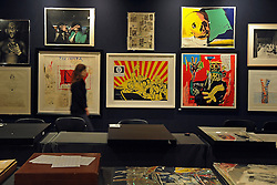 © Licensed to London News Pictures. 25/11/2011, London, UK. A Bonhams member of staff walks throughout the print room. Preview of Bonhams print sale today 25 November 2011. 'Single dollar' works by Andy Warhol feature in Bonhams' print sale which is being hung for viewing. The signed prints, estimated at between £15,000- 20,000, represent the link Warhol often made between art and money, underlined by the high prices paid for them by collectors at the time and ever since. Photo credit : Stephen Simpson/LNP