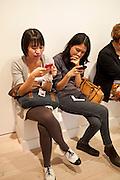 ISHA HENING; AIRI WULAN, Indonesian Eye Contemporary Art Exhibition Reception, Saatchi Gallery. London. 9 September 2011. <br /> <br />  , -DO NOT ARCHIVE-© Copyright Photograph by Dafydd Jones. 248 Clapham Rd. London SW9 0PZ. Tel 0207 820 0771. www.dafjones.com.