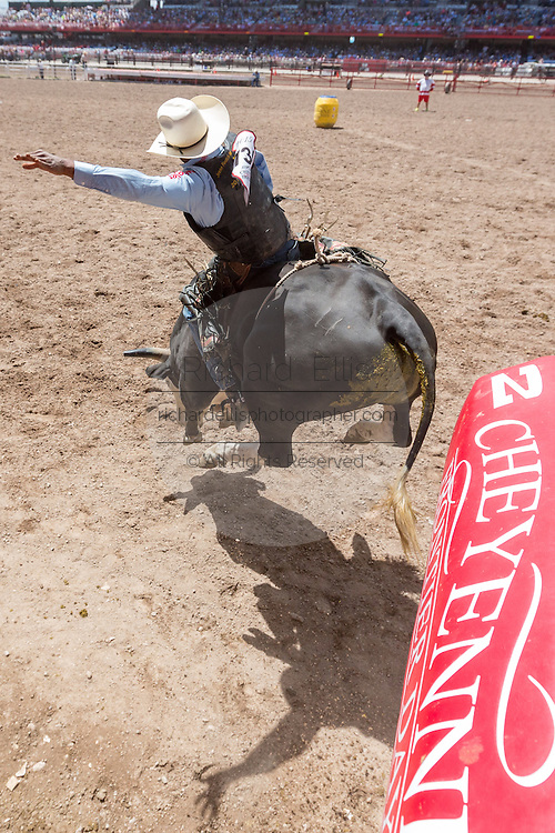 Bull rider Codrick Murphy of Houston, Texas breaks out of the chute at the Cheyenne Frontier Days rodeo at Frontier Park Arena July 25, 2015 in Cheyenne, Wyoming. Frontier Days celebrates the cowboy traditions of the west with a rodeo, parade and fair.