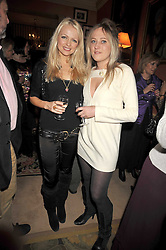 Left to right, HANNAH SANDLING and TALLULAH RENDALL at a party to celebrate the publication of 'A Lion called Christian' held at 36 Chapel Street, London SW1 on 26th March 2009.