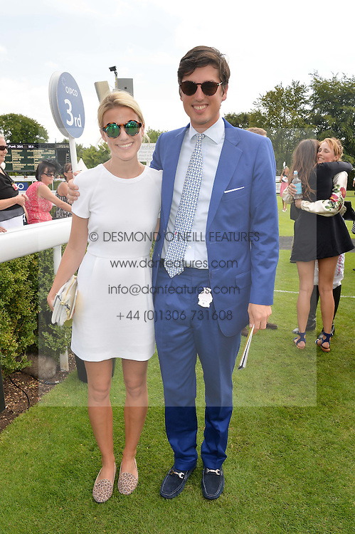 JAKE WARREN and his wife ZOE at the 2014 Glorious Goodwood Racing Festival at Goodwood racecourse, West Sussex on 31st July 2014.