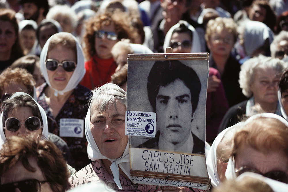 "(1992) The weekly march of Las Madres y las Abuelas de los Desparacidos (the mothers and grandmothers of the disappeared) in front of the Casa Rosada, the residence of the President of Argentina in Buenos Aires.  There was an estimated crowd of 700 people.  These groups demonstrated weekly for many years before the government admitted responsibility for thousands of political ""disappearances"" (murders). DNA Fingerprinting."