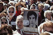 """(1992) The weekly march of Las Madres y las Abuelas de los Desparacidos (the mothers and grandmothers of the disappeared) in front of the Casa Rosada, the residence of the President of Argentina in Buenos Aires.  There was an estimated crowd of 700 people.  These groups demonstrated weekly for many years before the government admitted responsibility for thousands of political """"disappearances"""" (murders). DNA Fingerprinting."""