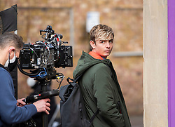 © Licensed to London News Pictures; 15/02/2021; Bristol, UK. OTTO FARRANT filming on location for Alex Rider. Filming takes place in Bristol for the second series of Alex Rider, a British spy thriller streaming television programme based on the novel series of the same name by Anthony Horowitz. The film stars Otto Farrant as Alex Rider, who is recruited by a subdivision of MI6 as a teenage spy to infiltrate places that others are unable to. Filming the second series has  been delayed due to coronavirus. Photo credit: Simon Chapman/LNP.