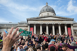 London, UK. 16 October, 2019. Jamie Kelsey Fry, contributing editor at the New Internationalist, addresses hundreds of Extinction Rebellion climate activists defying the Metropolitan Police prohibition on Extinction Rebellion Autumn Uprising protests throughout London under Section 14 of the Public Order Act 1986 by attending a Right to Protest assembly in Trafalgar Square.