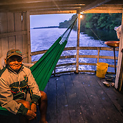 Mr. Moises. He used to live in Cucuì working as  cargo ship captain. Now He retired and moved to Sao Gabriel da Cachoeira. Here during the navigation along the Rio Negro, Amazonia, on the way to Cucuì, near the border between Brazil, Colombia and Venezuela
