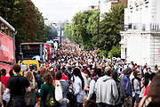 Crowds looking down Ladbroke Grove at Notting Hill Carnival in West London. The Notting Hill Carnival is an annual event which since 1964 has taken place each August, over two days (the August bank holiday Monday and the day beforehand). It is led by members of the West Indian / Caribbrean community, particularly the Trinidadian and Tobagonian British population, many of whom have lived in the area since the 1950s. The carnival has attracted up to 2 million people in the past, making it the second largest street festival in the world. The celebration centres around a parade of floats, dancers and sound systems.