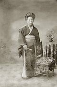 studio portrait of Asian woman in traditional dress.