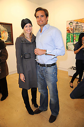 DOMINIC ST.GEORGE and SELINA TEAGUE at a Pop Up exhibition of Fine Art held at the Broadbent Gallery, 25 Chepstow Corner, Chepstow Place, London W2 on 7th December 2010.
