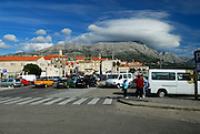 View of Town of Korcula, with distinctive cloud formation around peak on Croatian mainland (in background). Island of Korcula, Croatia