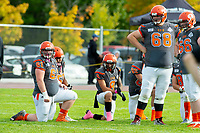 KELOWNA, BC - OCTOBER 6: Jackson Thomas #61, Bear Akachuk #55, Kian Ishani #8, take a knee while Jeff Vander Werff #68 and Daniel Townsend #66 of Okanagan Sun stand on the field during a stop in play against the VI Raiders at the Apple Bowl on October 6, 2019 in Kelowna, Canada. (Photo by Marissa Baecker/Shoot the Breeze)