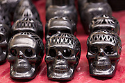 Black pottery skulls for the Day of the Dead festival at the Sunday market in Tlacolula de Matamoros, Mexico. The regional street market draws thousands of sellers and shoppers from throughout the Valles Centrales de Oaxaca.