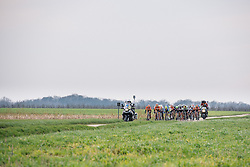 The lead group speed across exposed fields with two laps to go - 2016 Omloop van het Hageland - Tielt-Winge, a 129km road race starting and finishing in Tielt-Winge, on February 28, 2016 in Vlaams-Brabant, Belgium.