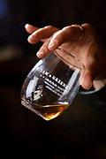 Heather Greene tates whisky in the rickhouse at Milam & Greene Distillery in Blanco, Texas.