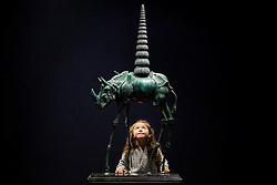 © Licensed to London News Pictures. 31/01/2013. London, UK. Five year old Sofia Lopez from Columbia views 'Chair de poule rhinocerontique, ou Rhinoceros cosmique' (conceived in 1956) (est. GB£150,000-250,000) a bronze sculpture by Spanish surrealist Salvador Dali at the press view for the Bonhams' Impressionist and Modern Art Sale in London today (31/01/13). The sale, to be held at the London based auction house's New Oxford Street premises on the 5th of February, features a selection of eclectic artists including Camille Pissarro, Fernand Leger and Edgar Degas. Photo credit: Matt Cetti-Roberts/LNP