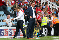 Peterborough United's manager Darren Ferguson and Swindon Town's manager Mark Cooper - Photo mandatory by-line: Joe Dent/JMP - Tel: Mobile: 07966 386802 03/08/2013 - SPORT - FOOTBALL -  London Road Stadium - Peterborough -  Peterborough United v Swindon Town - Sky Bet One