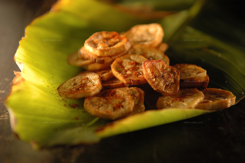 Kela chips - chips of green palantain ( Recipe available upon request )
