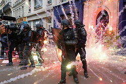 May 1, 2017 - Paris, France - Fire works explode around French riot police during May Day Protests in Paris. Thousands of people take to the streets of Paris on May Day or Labour Day to protest against the rise of the far-right in the French general elections. (Credit Image: © Visual via ZUMA Press)