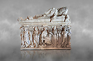 Roman sarcophagus with relief sculptures from Hierapolis . Hierapolis Archaeology Museum, Turkey<br /> <br /> Columned Sarcophagus Sarcopinagu of Euthios Pyrrnon, Asian Archon (ruler), Roman Period First quarter of third century A.D. Loadicea. <br />  <br /> Four sides of these sarcophagi are all in relief. They appear like a columned temple. The reliefs between the grooved columns are related to the private life of the individual. His/her education, heroic scenes and plant or mythological motifs are decorated in relief. The cover of the sarcophagus is arranged like a bed and it is depicted as the wife and the husband as lying on it. The name of the individual and some mythological reliefs are found in the surrounding of the cover. The two sarcophagi in the hall are of this kind. .<br /> <br /> If you prefer to buy from our ALAMY STOCK LIBRARY page at https://www.alamy.com/portfolio/paul-williams-funkystock/greco-roman-sculptures.html- Type - Hierapolis - into LOWER SEARCH WITHIN GALLERY box - Refine search by adding a subject, place, background colour, museum etc.<br /> <br /> Visit our CLASSICAL WORLD HISTORIC SITES PHOTO COLLECTIONS for more photos to download or buy as wall art prints https://funkystock.photoshelter.com/gallery-collection/The-Romans-Art-Artefacts-Antiquities-Historic-Sites-Pictures-Images/C0000r2uLJJo9_s0c