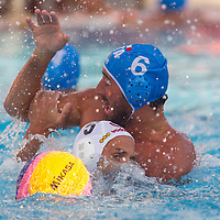 Tamas Kasas (front L) of Hungary fights against Maurizio Felugo (back R) of Italy during the Vodafone Waterpolo Cup in Budapest, Hungary on July 16, 2012. ATTILA VOLGYI