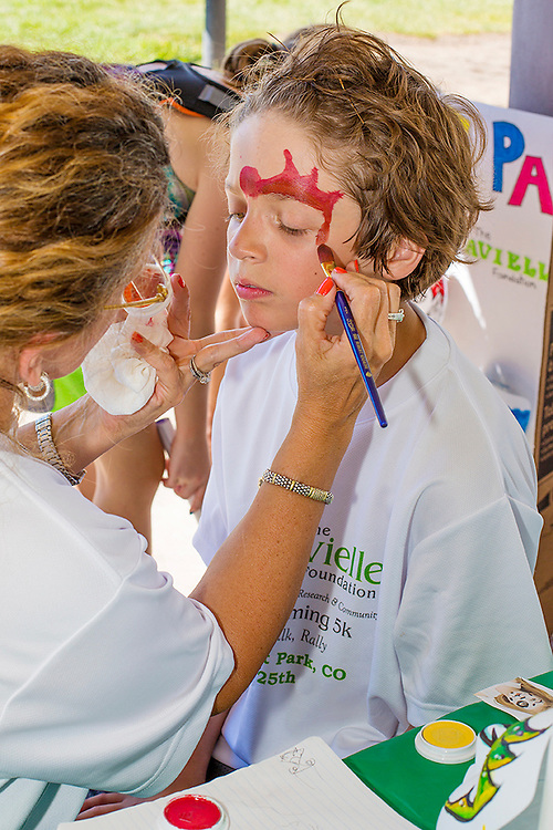 Face painting during charity event. Denver, Colorado