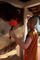 Temple School Novice Monks at Wat Siphoutthabat - Most male Lao youths spend time in a temple or monastery, before becoming adults.   The Buddhism practiced in Laos is of the Theravada tradition,  a  version of Theravada Buddhism and the foundation of Lao culture.