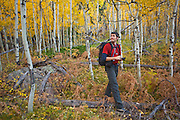 Obadiah Reid explores an aspen grove (Populus tremuloides) along the Fern Lake Trail, Rocky Mountain National Park, Colorado.