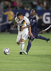 June 24, 2017 - Carson, California, U.S - Jose Villareal #33 of Los Angeles Galaxy is held by Gerso Fernandes of Sporting KC during their game at the StubHub Center on Saturday June 24, 2017 in Carson, California.  LA Galaxy loses to Sporting KC, 2-1. (Credit Image: © Prensa Internacional via ZUMA Wire)