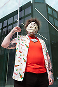 An Extinction Rebellion protestor, covered in tattoos and wearing a face mask with blood money written on it and a ten pound note taped to it, holds his fist up in solidarity with the Black Lives Matter movement on 27th August, 2021 in London, United Kingdom. The activist group Extinction Rebellion XR are planning actions of disruption for two weeks straight beginning on August 23rd, 2021 in an effort to bring awareness and priority to the global climate emergency in advance of the COP 26 Summit which will be held in Glasgow later this year.