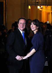 © under license to London News Pictures. LONDON. 05/05/2011. One year on since the last General Election. FILE PICTURE DATED.11/05/10. David Cameron and his wife Samantha turn back to look at the media as they enter Number 10 Downing Street after he became British Prime Minister. British Prime Minister Gordon Brown has resigned his position and David Cameron has become the new British Prime Minister on May 11, 2010. The Conservative and Liberal Democrats are to form a coalition government after five days of negotiation. Photo credit should read Stephen Simpson/LNP