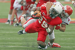 01 September 2012:  Marshaun Coprich makes yards through the middle but gets wrapped up by Kyle Sebetic during an NCAA football game between the Dayton Flyers and the Illinois State Redbirds at Hancock Stadium in Normal IL